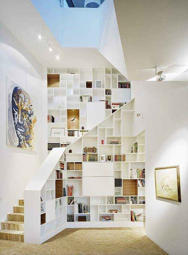 creative storage solutions under the stairs - a perfect bookcase